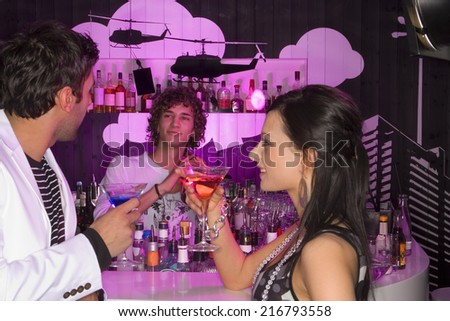 Three people at a bar - stock photo