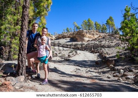 Three people family hiking in Teno national park. Walkway to the Lunar Landscape. Tenerife, Canary, Spain, Europe