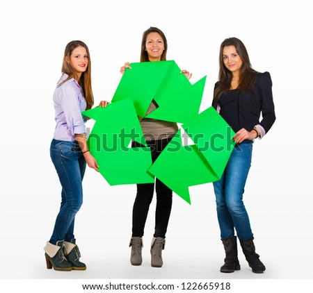 Three people holding a recycle sign - stock photo