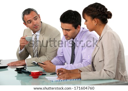 Three people on interview panel - stock photo