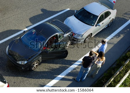 Three people stand by the roadside, discussing what has happened after a small shunt on the freeway (motorway, autoroute, autobahn). - stock photo