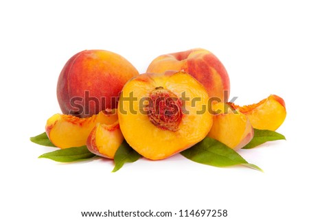 Three perfect, ripe peaches with a half  and slices isolated on a white background. - stock photo