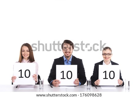 three person sitting and holding signs. man and two women smiling on white - stock photo