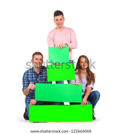 Three persons holding green tree shaped papers