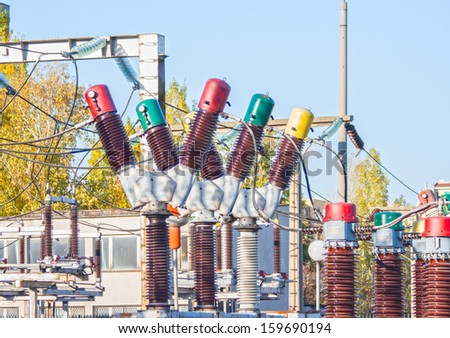 three phase ceramic high voltage electrical circuit breaker - stock photo