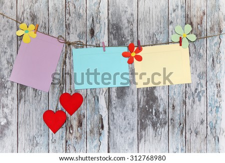 three photo paper attach to rope with clothes pins on wooden background - stock photo