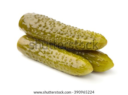 Three pickled cucumbers isolated on white - stock photo
