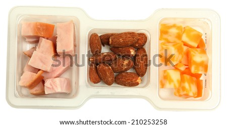 Three piece protien snack pack with salted almonds, smoked turkey and marble cheddar cheese. - stock photo