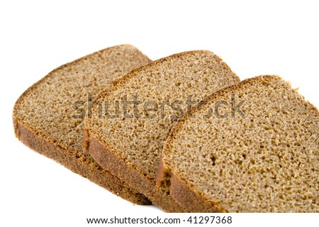 Three pieces of brown bread on white