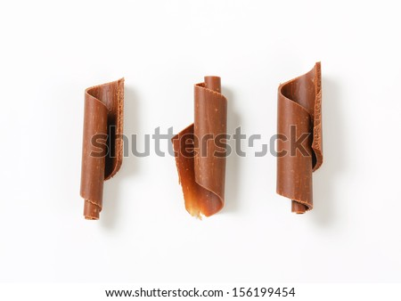 three pieces of chocolate curls isolated on a white background - stock photo
