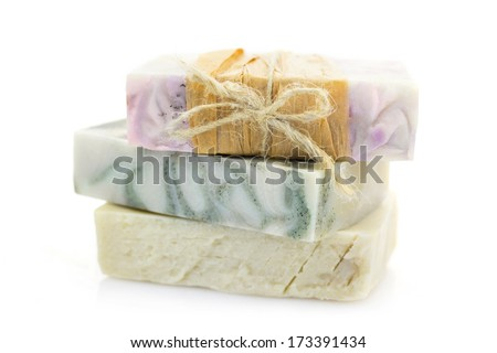 Three pieces of handmade soap isolated on white background - stock photo