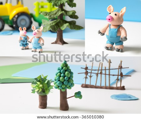 Three pigs made of plasticine - stock photo