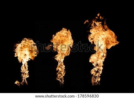three pillars of fire creating mushrooms of flames - stock photo