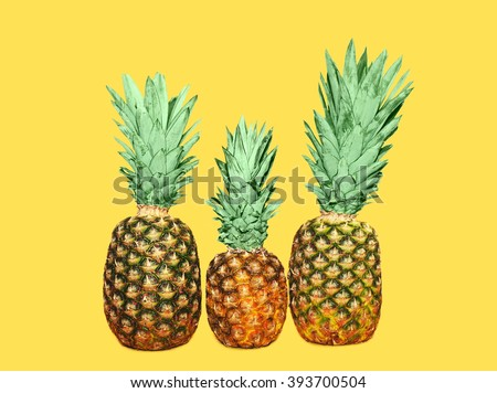Three pineapple on yellow background, colorful ananas - stock photo