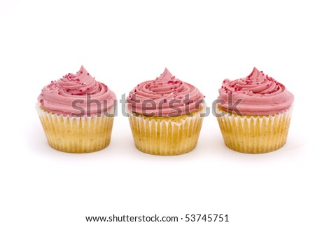 three pink cup cakes on a white background