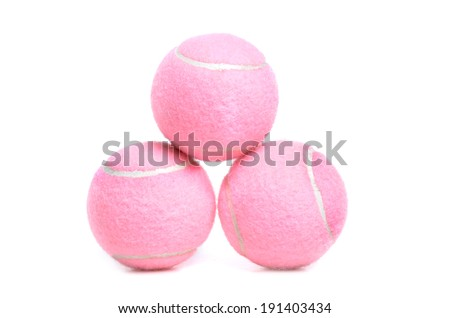 three pink tennis balls isolated white background