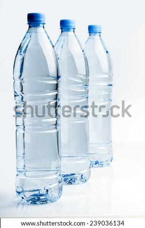 Three plastic bottles of water - stock photo