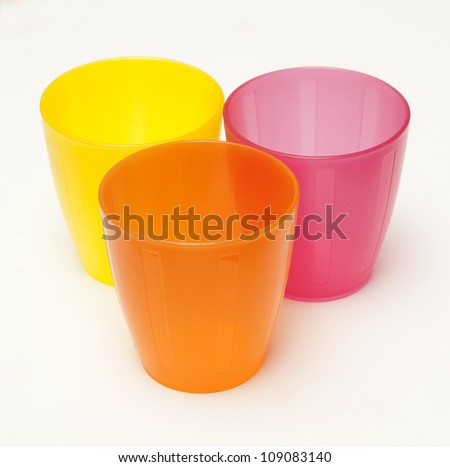 three plastic colored glasses isolated on  white background - stock photo