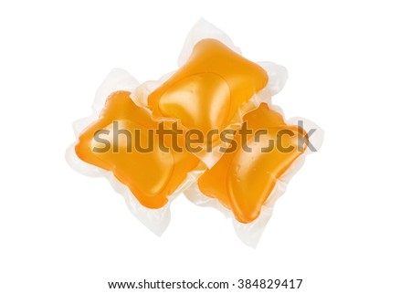 Three pods of washing detergent isolated on a white background with clipping path included.