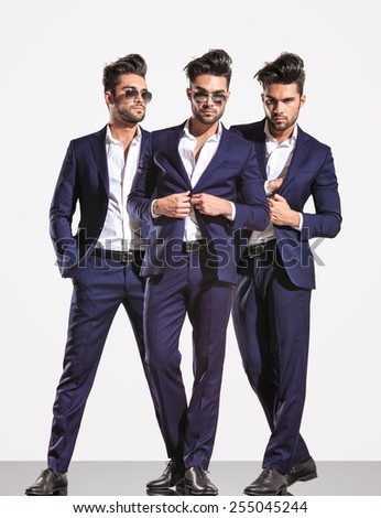 three poses of an elegant smart casual fashion business man on light gray background - stock photo