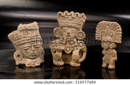 Three Pre Columbian Warriors Statues made around 600 AD. - stock photo