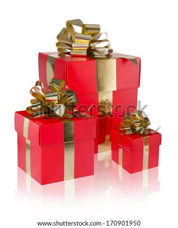 three present red with golden ribbon isolated on white - stock photo