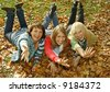"three pretty girls having fun. keyword for this collection is ""autumn77"" - stock photo"