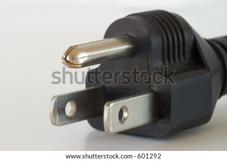 Three-pronged electrical plug, close-up macro.