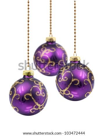 Three purple gold Christmas balls hanging on white background isolated - stock photo