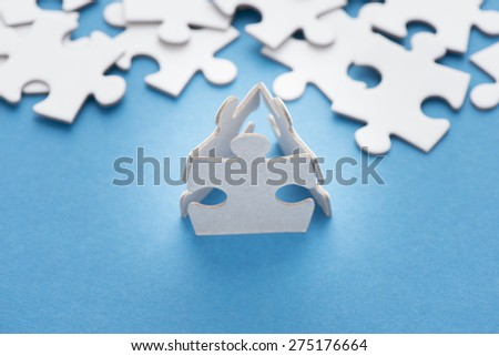 Three puzzle pieces. Conceptual image of connection, teamwork and business strategy. - stock photo