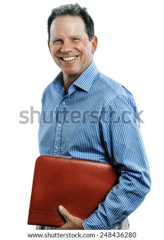 Three quarter length studio shot of a happy professional man wearing a dress shirt and holding a red leather binder.
