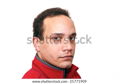 three quarter portrait of african american male wearing red shirt against white background looking serious