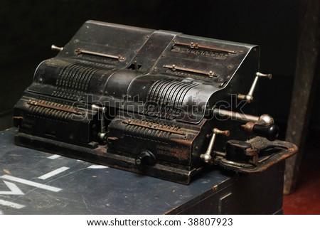 Three-quarter view of old adding machine - stock photo