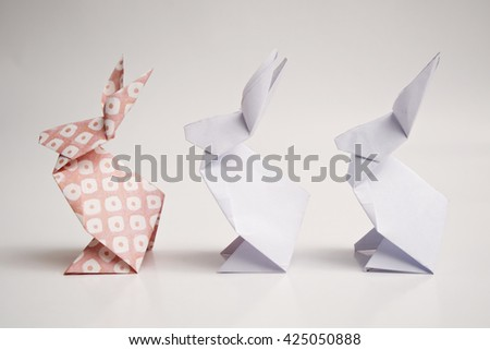 Three rabbits origami with white background - stock photo