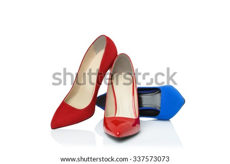three red and blue shoes on high heels isolated on white background