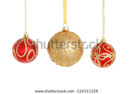 Three red and gold glitter Christmas baubles isolated against white