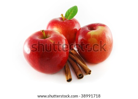 Three red apples with cinnamon on the white background - stock photo