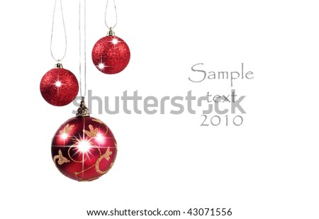 Three red baubles on a white background with space for text - can be used for christmas or new year