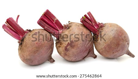 three red beetroots in row isolated on white  - stock photo