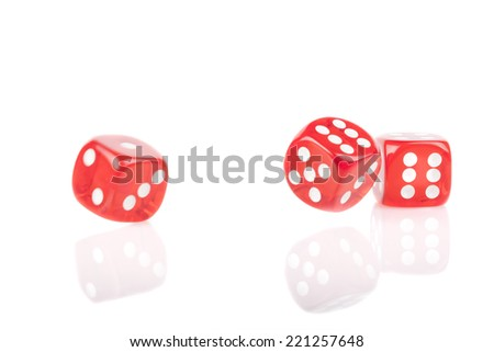Three red bouncing dice isolated on white background with reflection - stock photo