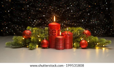 Three red Candles with Christmas tree branches decorated - stock photo