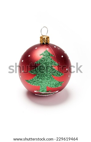 Three red christmas ball with green tree isolated white, top view at the studio. - stock photo