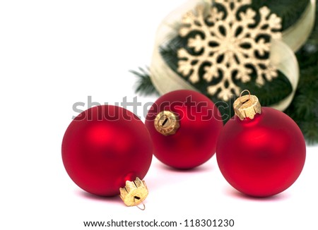 Three red christmas balls and fir, isolated on white, selective focus - stock photo