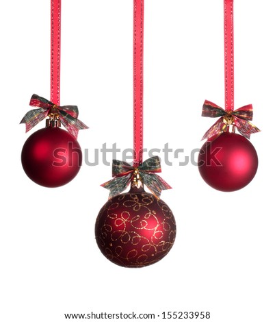 Three red Christmas balls isolated on white background