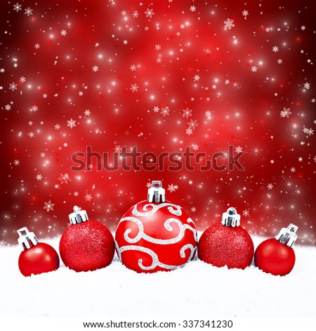 Three red christmas balls on red background - stock photo