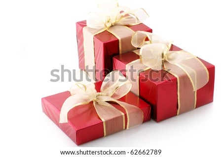 Three red foil gifts with golden bows isolated on white background. - stock photo