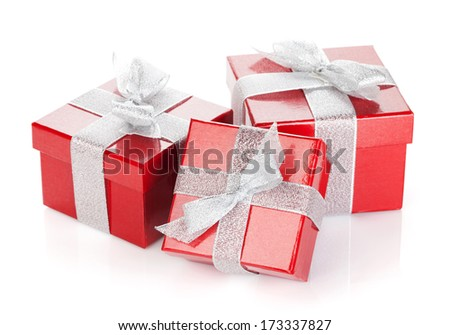 Three red gift boxes with silver ribbon and bow. Isolated on white background