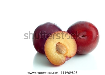 three red greengage on a white background