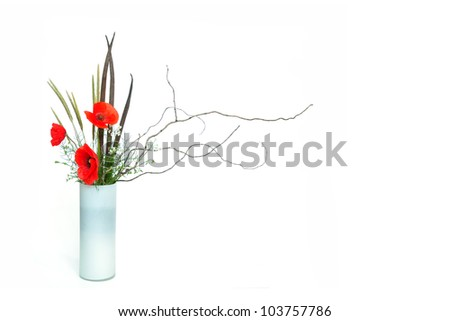 three red poppy ikebana nageire on white background