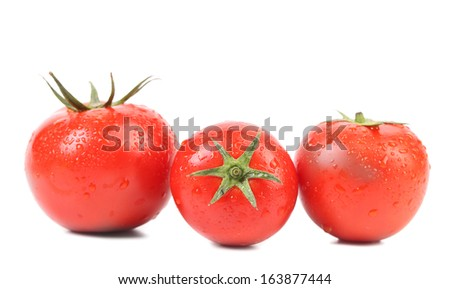 Three red ripe tomatoe. Isolated on a white background.